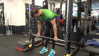Photo of Reverse-grip Smith Machine Row – Back Mass-Builder